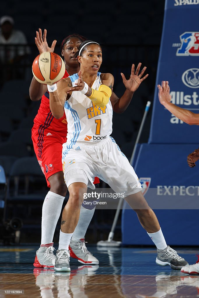 Tamera Young of the Chicago Sky looks to pass while guarded by Nicky Anosike of the Washington Mystics during the WNBA game on August 26 2011 at the...
