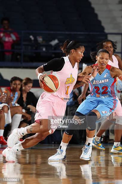 Tamera Young of the Chicago Sky moves the ball past Arminte Price of the Atlanta Dream on September 20 2012 at the Allstate Arena in Rosemont...