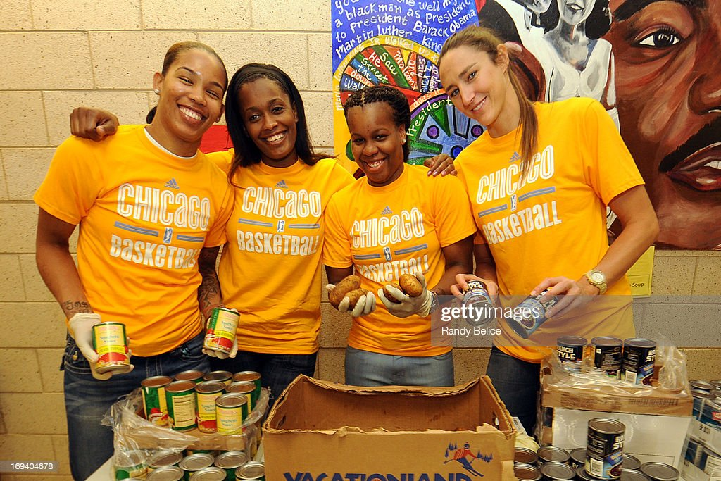 Tamera Young #1, Swin Cash #8, Epiphanny Prince #10 and Ruth Riley #00 of the Chicago Sky pose for a picture during a Chicago Sky Cares food distribution event in partnership with the Greater Chicago Food Depostitory on May 22, 2013 at the Jacob Beidler Elementary School in Chicago, Illinois. The event is part of the WNBA Cares week of service activities.