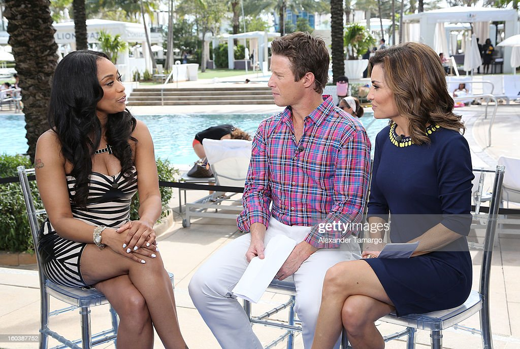 Tami Roman, Billy Bush and Catherine 'Kit' Hoover attend Access Hollywood cabana at NAPTE 2013 at Fontainebleau Miami Beach on January 30, 2013 in Miami Beach, Florida.