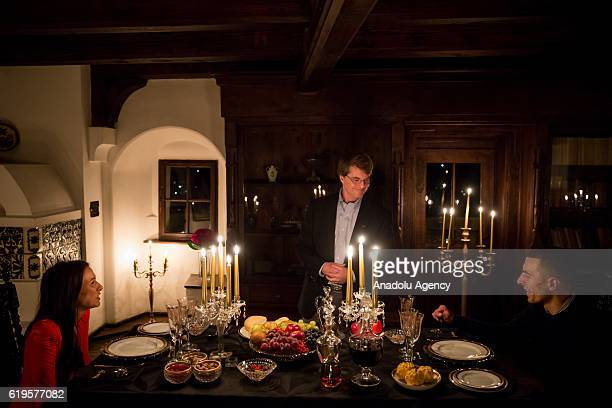 Tami Varma and her brother Robin talk to Dacre Stoker the descendant of Bram Stoker at their dinner at Bran castle in Bran Romania on October 31 2016...