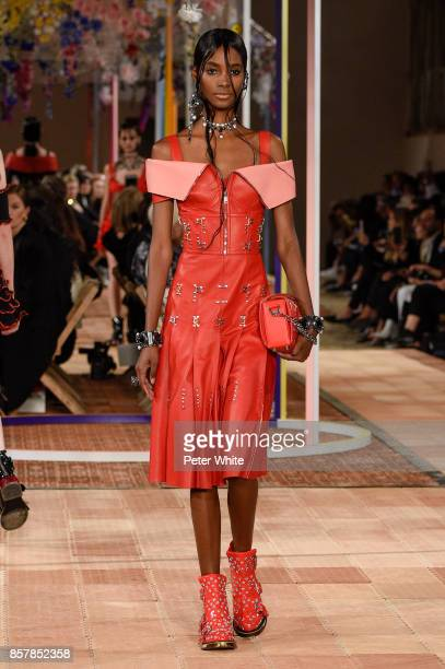 Tami Williams walks the runway during the Alexander McQueen Paris show as part of the Paris Fashion Week Womenswear Spring/Summer 2018 on October 2...