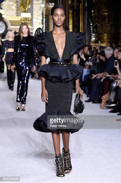 Tami Williams walks the runway during the Balmain show as part of the Paris Fashion Week Womenswear Spring/Summer 2018 on September 28 2017 in Paris...