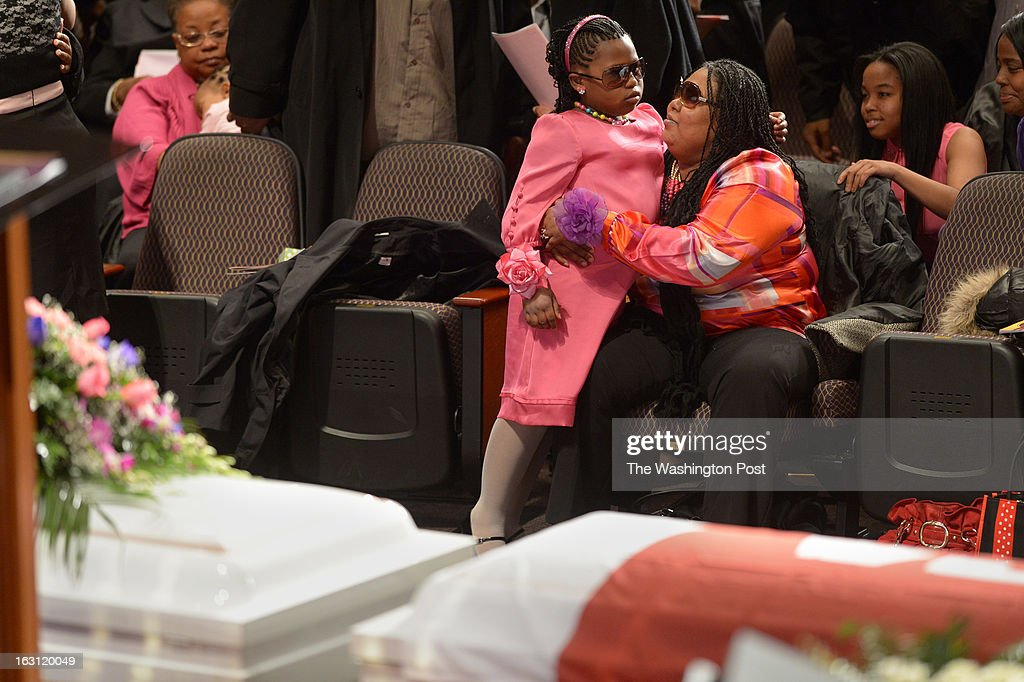 Tamia Price is held by her mother, Teresa Myles-Price as they mourn at a memorial service for Darrell Price Jr. and his daughters, Patrice Price, Tania Price, and Daijah Price at First Baptist Church of Glenarden on Monday March 04, 2013 in Upper Marlboro, MD. The four died as a result of a house fire last month. Teresa was the wife of Darrell and mother to the three girls. Tamia was Darrell's daughter and sister to the three girls, Patrice, Tania, and Daijah.