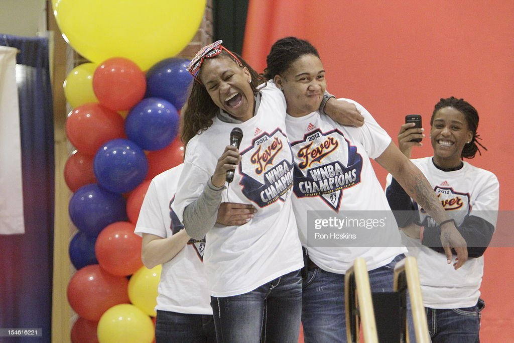 Tamika Catchings and Erlana Larkins of the Indiana Fever have some fun during the Indiana Fever's WNBA Championship celebration on October 23, 2012 at Bankers Life Fieldhouse in Indianapolis, Indiana.