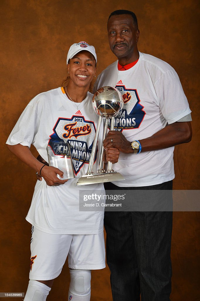 Tamika Catchings #24 and her dad Harvey Catchings of the Indiana Fever poses for portraits with the Championship Trophy after Game four of the 2012 WNBA Finals on October 21, 2012 at Bankers Life Fieldhouse in Indianapolis, Indiana.