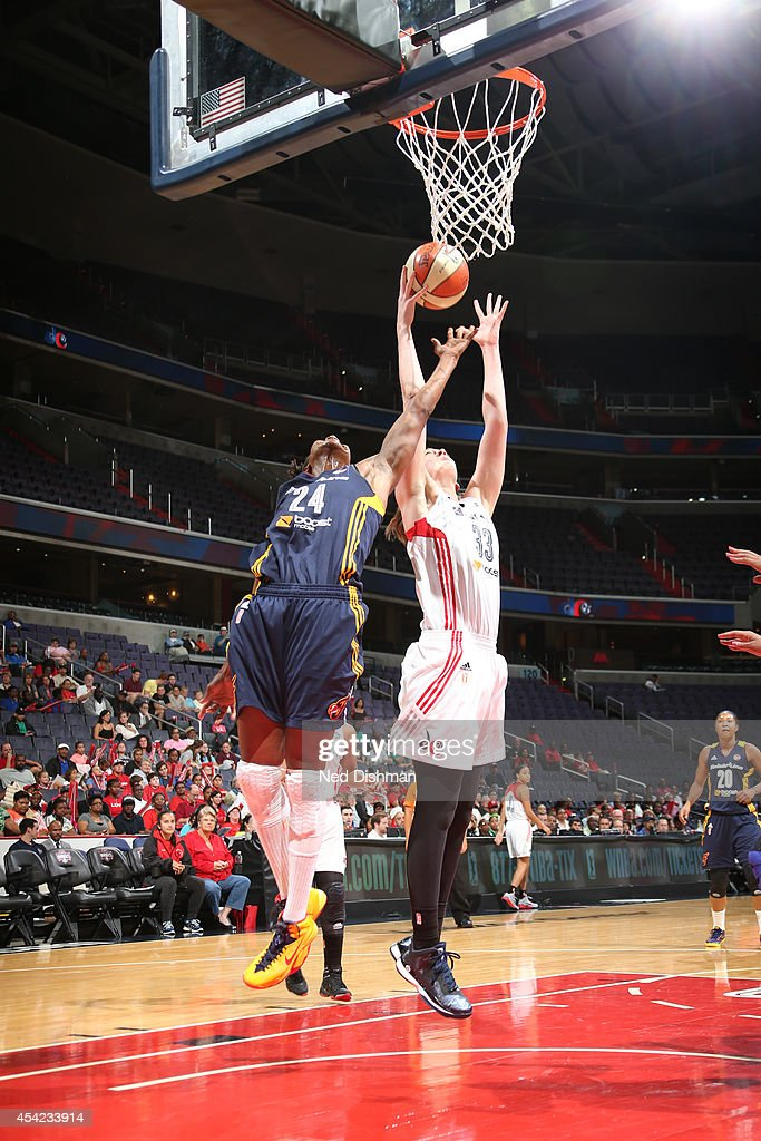Tamika Catchings #24 of the Indiana Fever and Emma Meesseman #33 of the Washington Mystics attempt to rebound the ball in Game Two of the Eastern Conference Semifinals during the 2014 WNBA Playoffs on August 23, 2014 at the Verizon Center in Washington, DC.