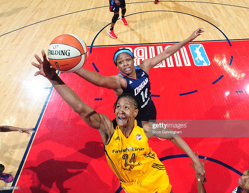 <a gi-track='captionPersonalityLinkClicked' href=/galleries/search?phrase=Tamika+Catchings&family=editorial&specificpeople=202220 ng-click='$event.stopPropagation()'>Tamika Catchings</a> #24 of the Indiana Fever and Rachel Hollivay #14 of the Atlanta Dream go after a rebound on May 29, 2016 at Philips Arena in Atlanta, Georgia.