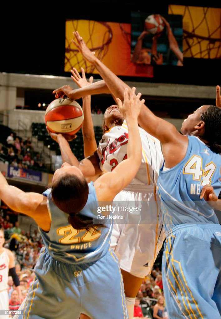 Tamika Catchings of the Indiana Fever battles Armintie Price and Chasity Melvin of the Chicago Sky at Conseco Fieldhouse on July 12 2008 in...