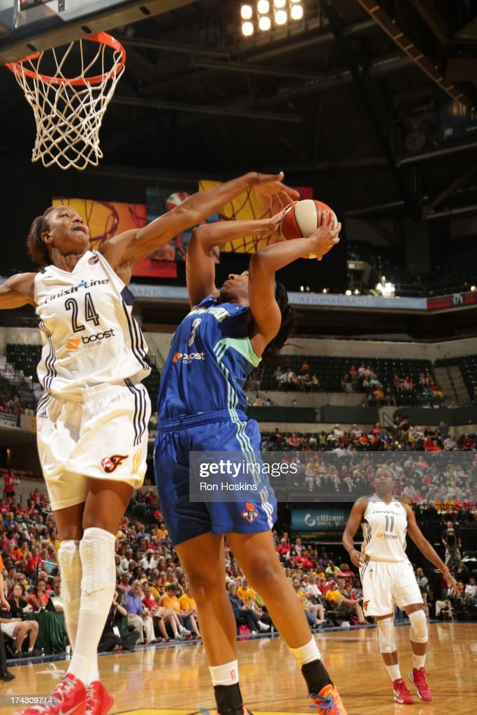 <a gi-track='captionPersonalityLinkClicked' href=/galleries/search?phrase=Tamika+Catchings&family=editorial&specificpeople=202220 ng-click='$event.stopPropagation()'>Tamika Catchings</a> #24 of the Indiana Fever battles <a gi-track='captionPersonalityLinkClicked' href=/galleries/search?phrase=Kelsey+Bone&family=editorial&specificpeople=5792056 ng-click='$event.stopPropagation()'>Kelsey Bone</a> #3 of the New York Liberty on July 23, 2013 at Bankers Life Fieldhouse in Indianapolis, Indiana.