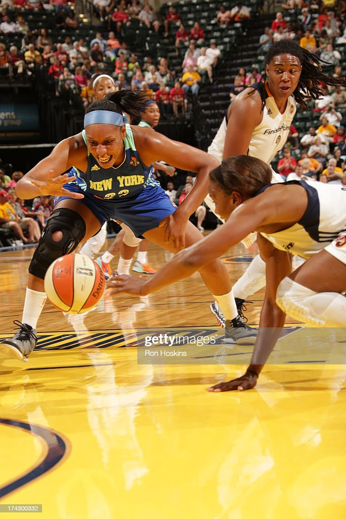 <a gi-track='captionPersonalityLinkClicked' href=/galleries/search?phrase=Tamika+Catchings&family=editorial&specificpeople=202220 ng-click='$event.stopPropagation()'>Tamika Catchings</a> #24 of the Indiana Fever battles Pienette Pierson #33 of the New York Liberty on July 23, 2013 at Bankers Life Fieldhouse in Indianapolis, Indiana.