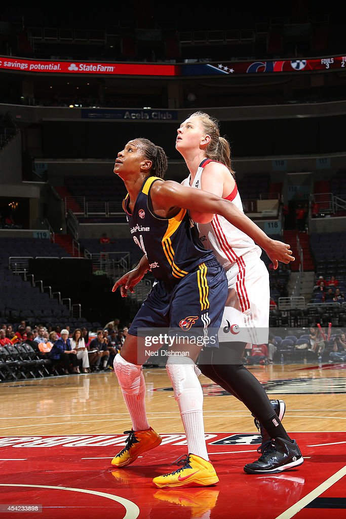 Tamika Catchings #24 of the Indiana Fever boxes out against Emma Meesseman #33 of the Washington Mystics in Game Two of the Eastern Conference Semifinals during the 2014 WNBA Playoffs on August 23, 2014 at the Verizon Center in Washington, DC.