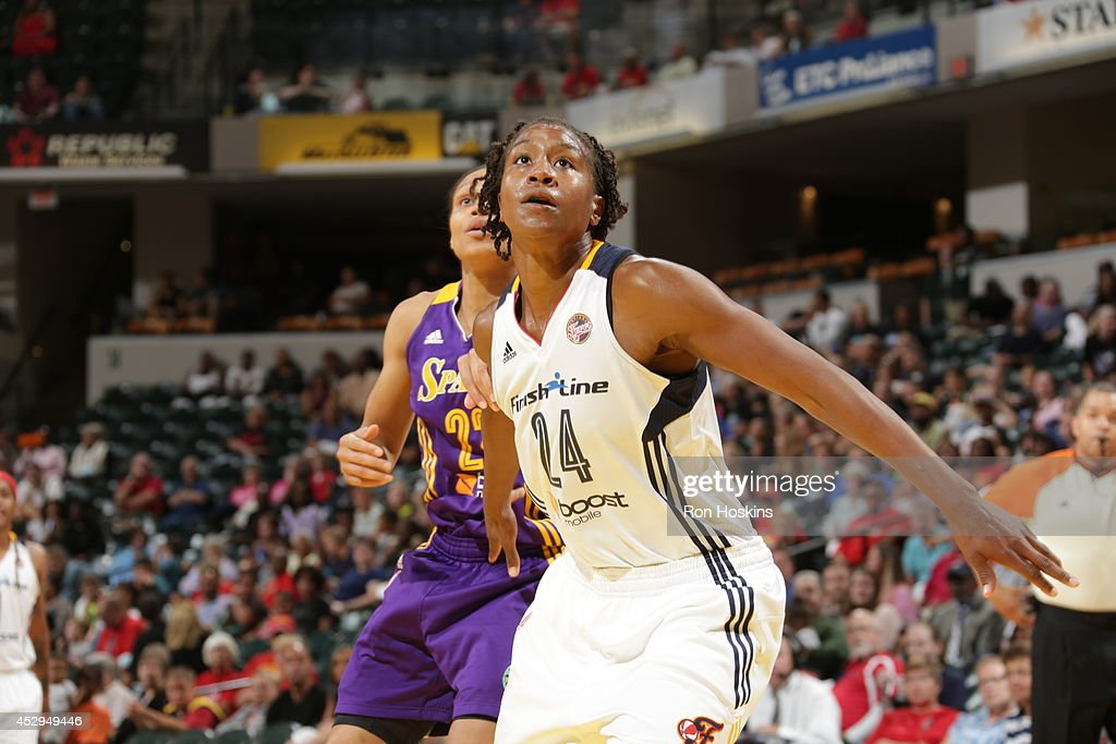<a gi-track='captionPersonalityLinkClicked' href=/galleries/search?phrase=Tamika+Catchings&family=editorial&specificpeople=202220 ng-click='$event.stopPropagation()'>Tamika Catchings</a> #24 of the Indiana Fever boxes out against the Los Angeles Sparks on July 15, 2014 at Bankers Life Fieldhouse in Indianapolis, Indiana.
