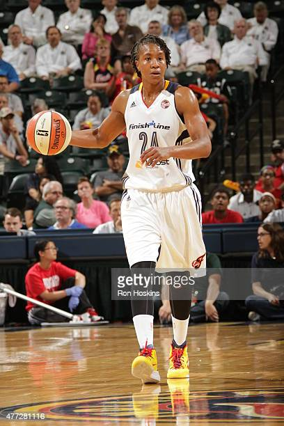 Tamika Catchings of the Indiana Fever brings the ball up court against the Phoenix Mercury on June 12 2015 at Bankers Life Fieldhouse in Indianapolis...