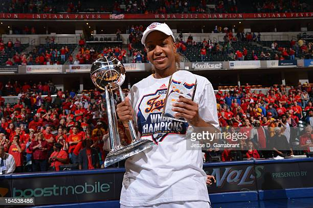 Tamika Catchings of the Indiana Fever celebrates with the Championship Trophy and MVP Award after defeating the Minnesota Lynx during Game four of...