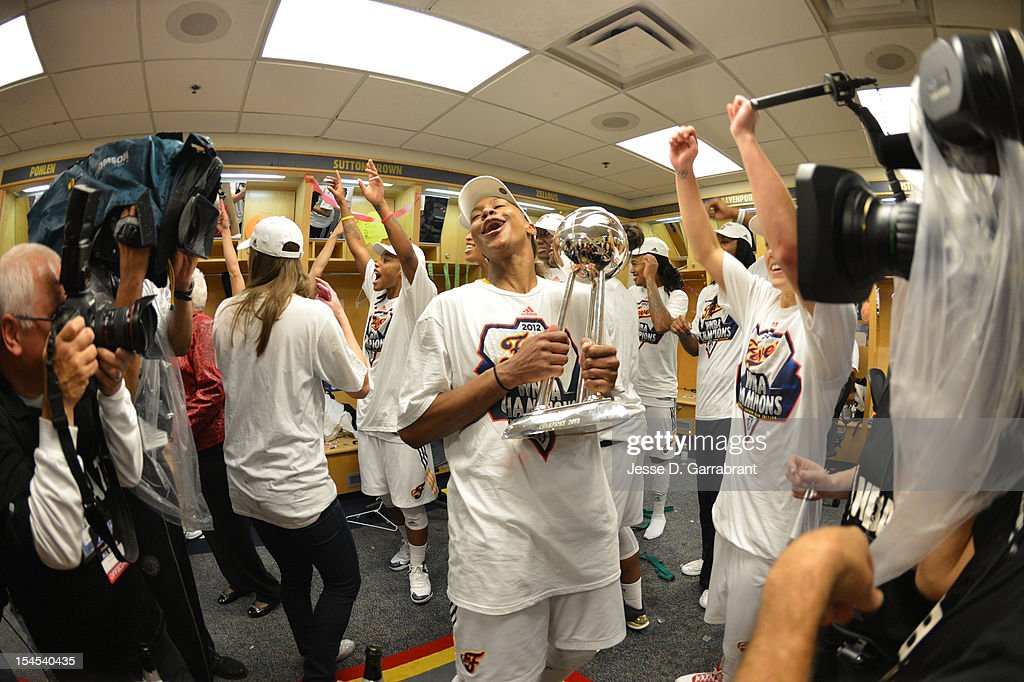 Tamika Catchings #24 of the Indiana Fever celebrates with the Championship Trophy in the locker room after defeating the Minnesota Lynx in Game four of the 2012 WNBA Finals on October 21, 2012 at Bankers Life Fieldhouse in Indianapolis, Indiana.