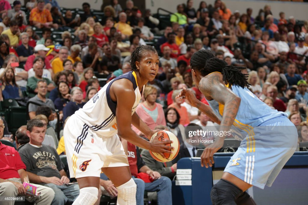 <a gi-track='captionPersonalityLinkClicked' href=/galleries/search?phrase=Tamika+Catchings&family=editorial&specificpeople=202220 ng-click='$event.stopPropagation()'>Tamika Catchings</a> #24 of the Indiana Fever controls the ball against the Chicago Sky on July 17, 2014 at Bankers Life Fieldhouse in Indianapolis, Indiana.