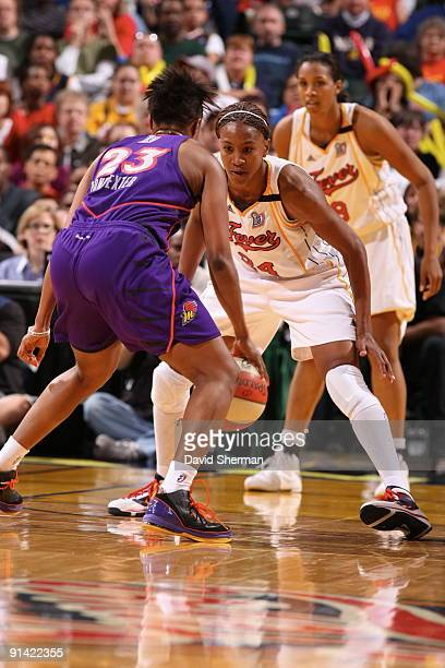 Tamika Catchings of the Indiana Fever defends against Cappie Pondexter of the Phoenix Mercury in Game Three of the WNBA Finals on October 4 2009 at...