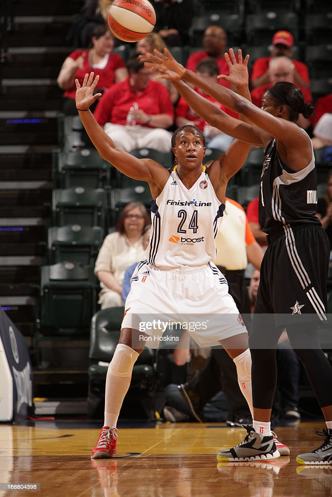 Tamika Catchings #24 of the Indiana Fever defends against the San Antonio Silver Stars on May 13, 2013 at Bankers Life Fieldhouse in Indianapolis, Indiana.