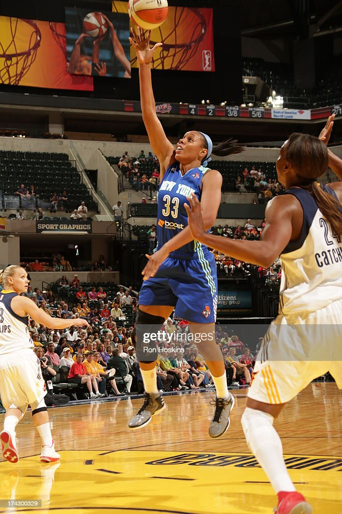 <a gi-track='captionPersonalityLinkClicked' href=/galleries/search?phrase=Tamika+Catchings&family=editorial&specificpeople=202220 ng-click='$event.stopPropagation()'>Tamika Catchings</a> #24 of the Indiana Fever defends Pienette Pierson #33 of the New York Liberty on July 23, 2013 at Bankers Life Fieldhouse in Indianapolis, Indiana.