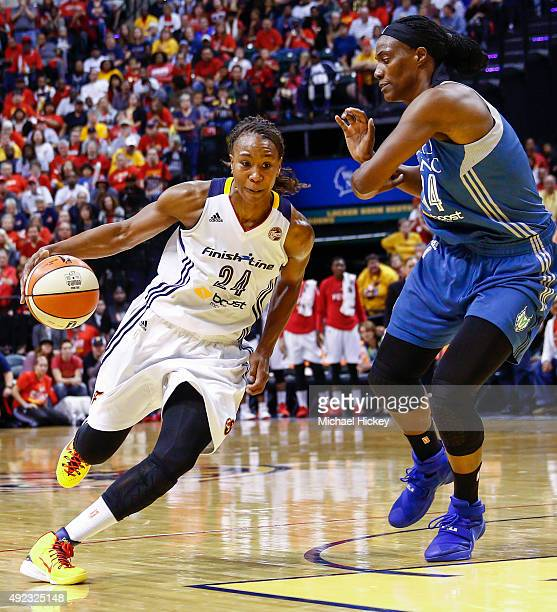 Tamika Catchings of the Indiana Fever dribbles the ball around Sylvia Fowles of the Minnesota Lynx at Bankers Life Fieldhouse on October 11 2015 in...