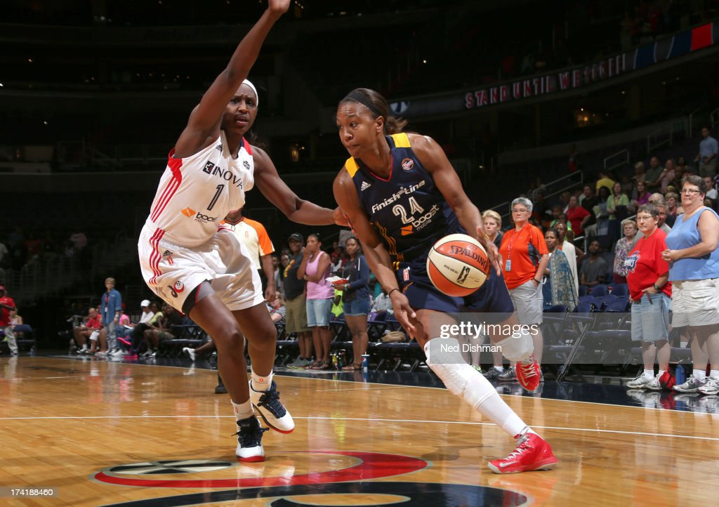 <a gi-track='captionPersonalityLinkClicked' href=/galleries/search?phrase=Tamika+Catchings&family=editorial&specificpeople=202220 ng-click='$event.stopPropagation()'>Tamika Catchings</a> #24 of the Indiana Fever drives against <a gi-track='captionPersonalityLinkClicked' href=/galleries/search?phrase=Crystal+Langhorne&family=editorial&specificpeople=700514 ng-click='$event.stopPropagation()'>Crystal Langhorne</a> #1 of the Washington Mystics at the Verizon Center on July 21, 2013 in Washington, DC.
