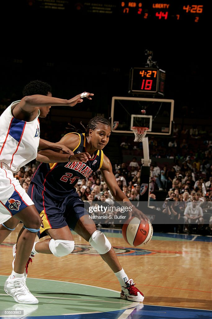 Tamika Catchings of the Indiana Fever drives against Crystal Robinson of the New York Liberty in Game One of the Eastern Conference Semis during the...