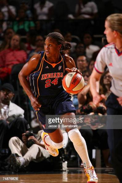 Tamika Catchings of the Indiana Fever drives against the New York Liberty June 24 2007 at Madison Square Garden in New York City NOTE TO USER User...