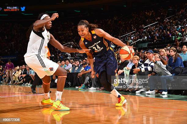 Tamika Catchings of the Indiana Fever drives baseline against the New York Liberty during game Three of the WNBA Eastern Conference Finals at Madison...