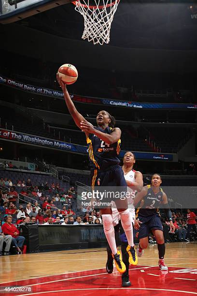 Tamika Catchings of the Indiana Fever drives to the basket against the Washington Mystics in Game Two of the Eastern Conference Semifinals during the...