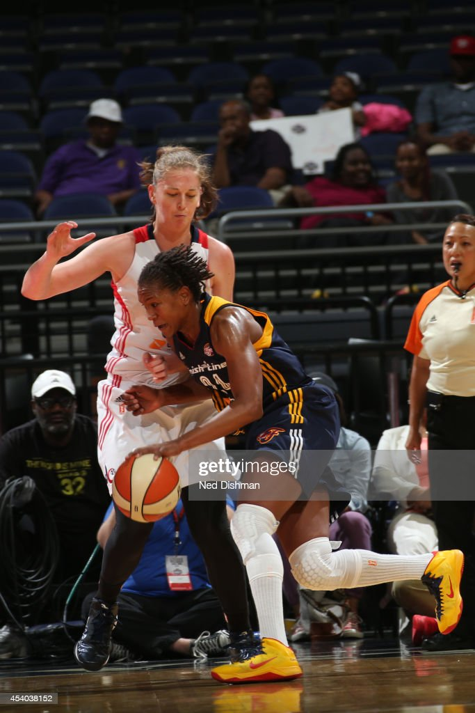 Tamika Catchings #24 of the Indiana Fever drives to the basket against Emma Meesseman #33 of the Washington Mystics in Game Two of the Eastern Conference Semifinals during the 2014 WNBA Playoffs on August 23, 2014 at the Verizon Center in Washington, DC.