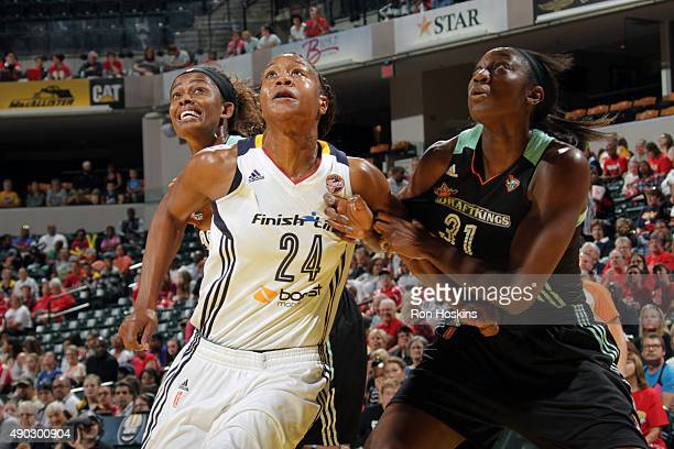 Tamika Catchings of the Indiana Fever fights for position against Swin Cash and Tina Charles of the New York Liberty in game two of the WNBA Eastern...