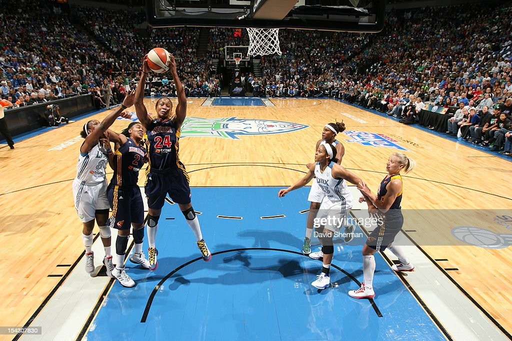 <a gi-track='captionPersonalityLinkClicked' href=/galleries/search?phrase=Tamika+Catchings&family=editorial&specificpeople=202220 ng-click='$event.stopPropagation()'>Tamika Catchings</a> #24 of the Indiana Fever grabs the rebound against <a gi-track='captionPersonalityLinkClicked' href=/galleries/search?phrase=Taj+McWilliams-Franklin&family=editorial&specificpeople=213186 ng-click='$event.stopPropagation()'>Taj McWilliams-Franklin</a> #8 of the Minnesota Lynx during the 2012 WNBA Finals Game Two on October 17, 2012 at Target Center in Minneapolis, Minnesota.
