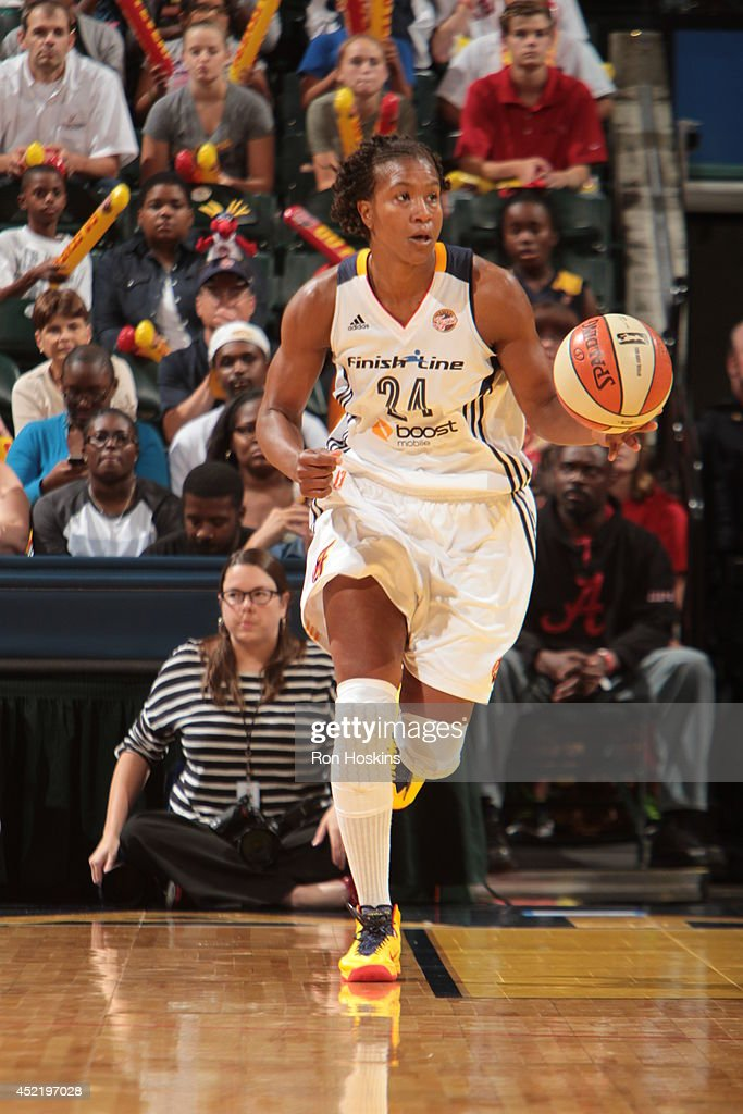 <a gi-track='captionPersonalityLinkClicked' href=/galleries/search?phrase=Tamika+Catchings&family=editorial&specificpeople=202220 ng-click='$event.stopPropagation()'>Tamika Catchings</a> #24 of the Indiana Fever handles the ball against the Los Angeles Sparks on July 15, 2014 at Bankers Life Fieldhouse in Indianapolis, Indiana.