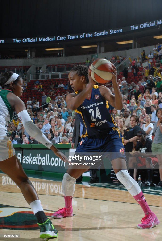 <a gi-track='captionPersonalityLinkClicked' href=/galleries/search?phrase=Tamika+Catchings&family=editorial&specificpeople=202220 ng-click='$event.stopPropagation()'>Tamika Catchings</a> #24 of the Indiana Fever handles the ball against the Seattle Storm on July 31,2014 at Key Arena in Seattle, Washington.
