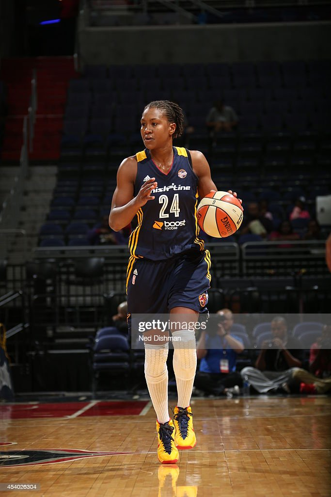 <a gi-track='captionPersonalityLinkClicked' href=/galleries/search?phrase=Tamika+Catchings&family=editorial&specificpeople=202220 ng-click='$event.stopPropagation()'>Tamika Catchings</a> #24 of the Indiana Fever handles the ball against the Washington Mystics in Game Two of the Eastern Conference Semifinals during the 2014 WNBA Playoffs on August 23, 2014 at the Verizon Center in Washington, DC.