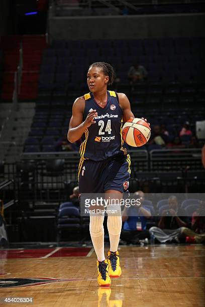 Tamika Catchings of the Indiana Fever handles the ball against the Washington Mystics in Game Two of the Eastern Conference Semifinals during the...