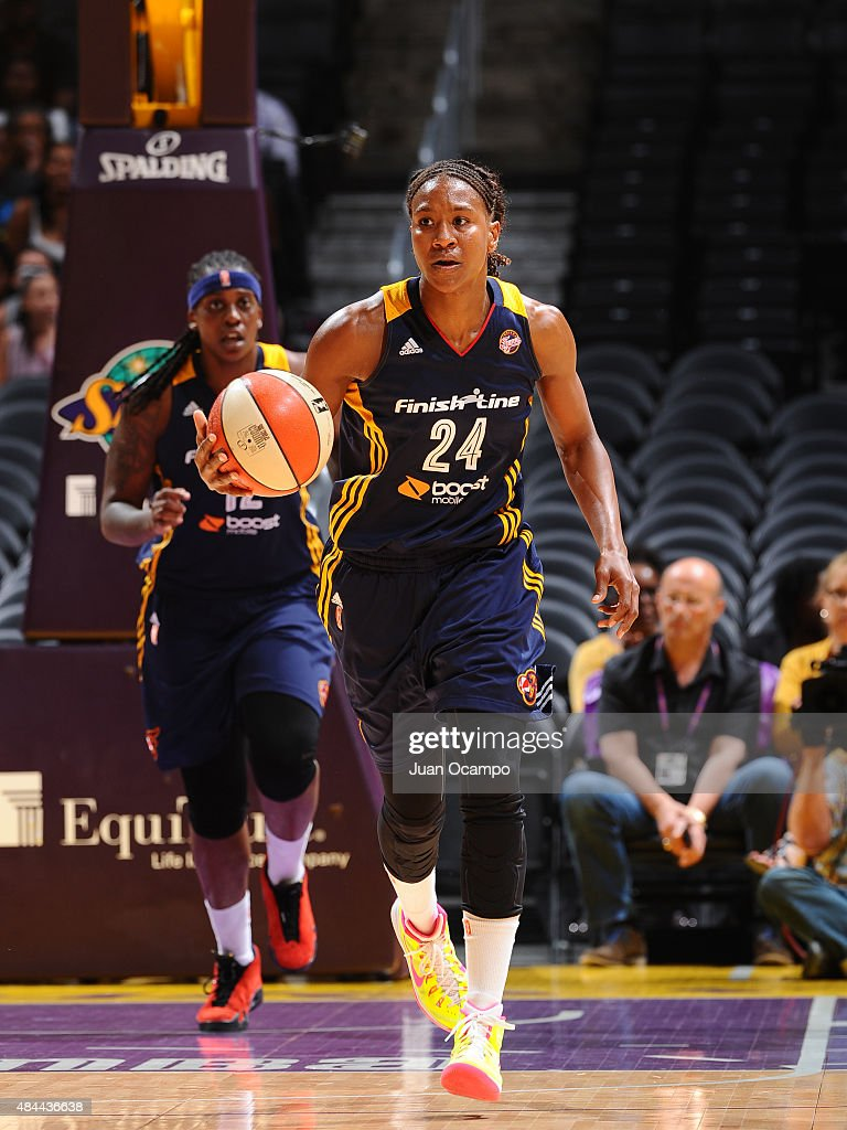 <a gi-track='captionPersonalityLinkClicked' href=/galleries/search?phrase=Tamika+Catchings&family=editorial&specificpeople=202220 ng-click='$event.stopPropagation()'>Tamika Catchings</a> #24 of the Indiana Fever handles the ball against the Los Angeles Sparks on August 18, 2015 at STAPLES Center in Los Angeles, California.