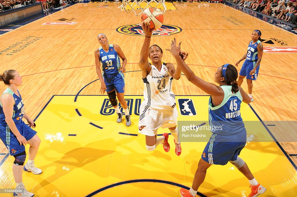 <a gi-track='captionPersonalityLinkClicked' href=/galleries/search?phrase=Tamika+Catchings&family=editorial&specificpeople=202220 ng-click='$event.stopPropagation()'>Tamika Catchings</a> #24 of the Indiana Fever lays the ball up on <a gi-track='captionPersonalityLinkClicked' href=/galleries/search?phrase=Kara+Braxton&family=editorial&specificpeople=226695 ng-click='$event.stopPropagation()'>Kara Braxton</a> #45 of the New York Liberty on July 23, 2013 at Bankers Life Fieldhouse in Indianapolis, Indiana.