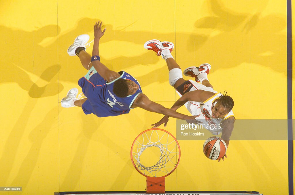 Tamika Catchings of the Indiana Fever lays the ball up over Crystal Robinson of the New York Liberty in Game Two of the Eastern Conference Semis...