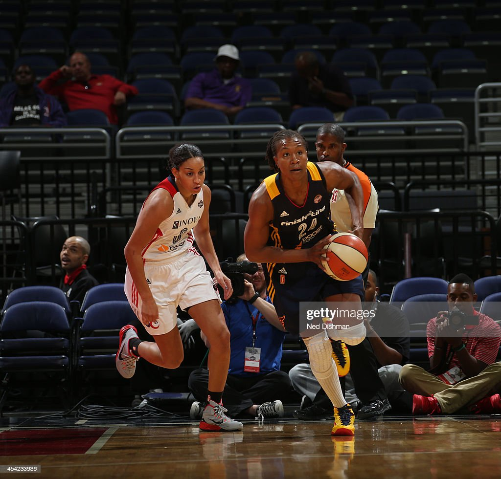 Tamika Catchings #24 of the Indiana Fever looks to pass the ball against the Washington Mystics in Game Two of the Eastern Conference Semifinals during the 2014 WNBA Playoffs on August 23, 2014 at the Verizon Center in Washington, DC.