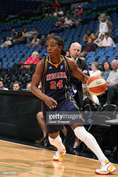Tamika Catchings of the Indiana Fever moves the ball against the Minnesota Lynx during the WNBA game on May 29 2007 at Target Center in Minneapolis...