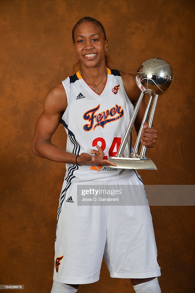 Tamika Catchings #24 of the Indiana Fever poses for portraits with the Championship Trophy after Game four of the 2012 WNBA Finals on October 21, 2012 at Bankers Life Fieldhouse in Indianapolis, Indiana.