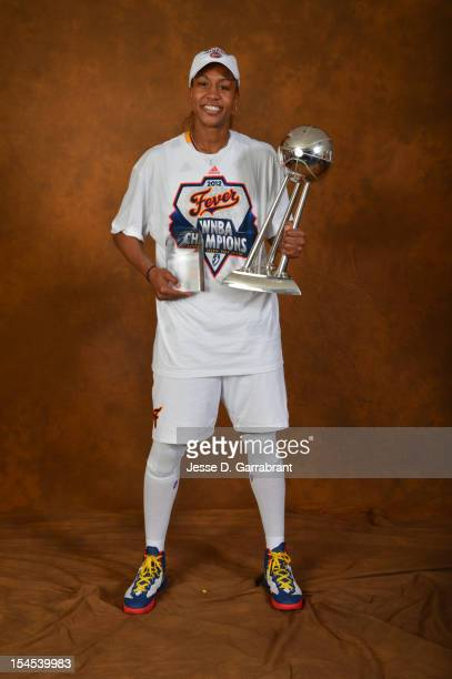 Tamika Catchings of the Indiana Fever poses for portraits with the Championship Trophy and MVP Award after Game four of the 2012 WNBA Finals on...