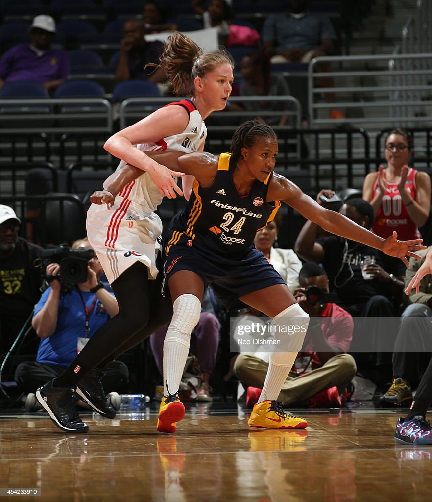 Tamika Catchings #24 of the Indiana Fever posts up against Emma Meesseman #33 of the Washington Mystics in Game Two of the Eastern Conference Semifinals during the 2014 WNBA Playoffs on August 23, 2014 at the Verizon Center in Washington, DC.