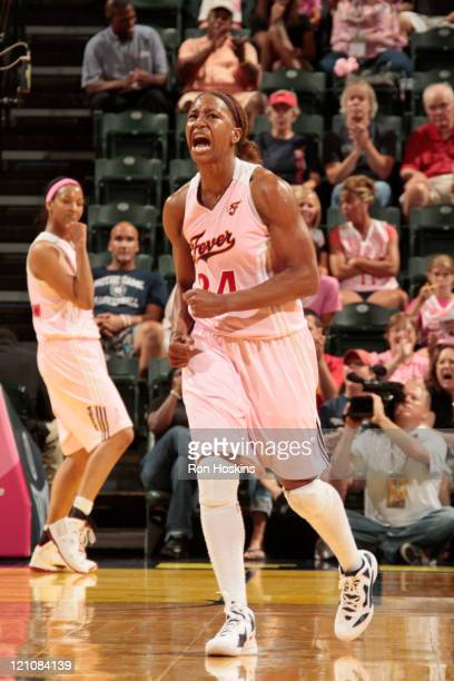 Tamika Catchings of the Indiana Fever reacts after a play against the New York Liberty at Conseco Fieldhouse on August 13 2011 in Indianapolis...