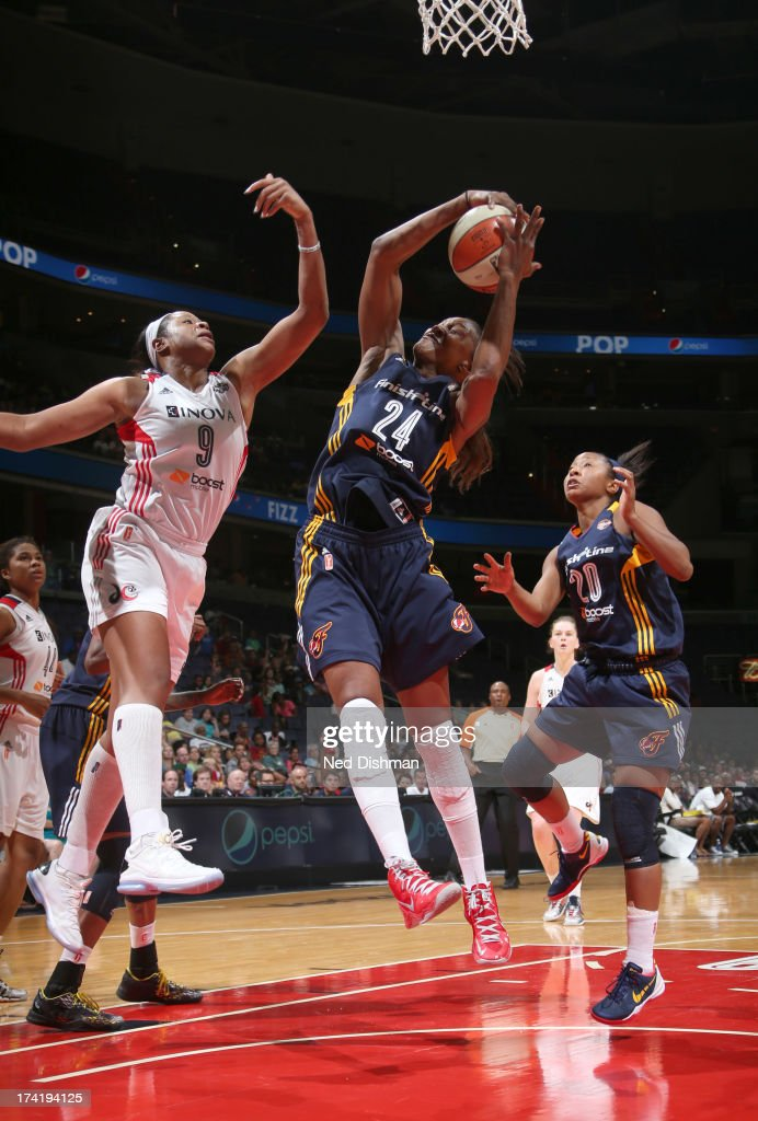 <a gi-track='captionPersonalityLinkClicked' href=/galleries/search?phrase=Tamika+Catchings&family=editorial&specificpeople=202220 ng-click='$event.stopPropagation()'>Tamika Catchings</a> #24 of the Indiana Fever rebounds against <a gi-track='captionPersonalityLinkClicked' href=/galleries/search?phrase=Kia+Vaughn&family=editorial&specificpeople=4220876 ng-click='$event.stopPropagation()'>Kia Vaughn</a> #9 of the Washington Mystics at the Verizon Center on July 21, 2013 in Washington, DC.