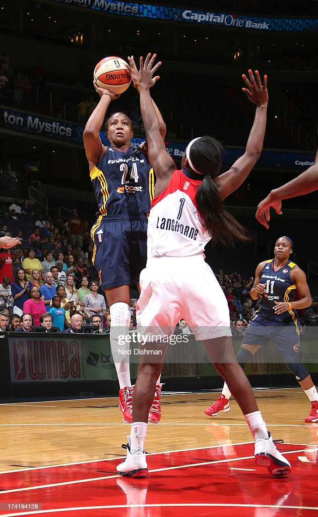 <a gi-track='captionPersonalityLinkClicked' href=/galleries/search?phrase=Tamika+Catchings&family=editorial&specificpeople=202220 ng-click='$event.stopPropagation()'>Tamika Catchings</a> #24 of the Indiana Fever shoots against <a gi-track='captionPersonalityLinkClicked' href=/galleries/search?phrase=Crystal+Langhorne&family=editorial&specificpeople=700514 ng-click='$event.stopPropagation()'>Crystal Langhorne</a> #1 of the Washington Mystics at the Verizon Center on July 21, 2013 in Washington, DC.
