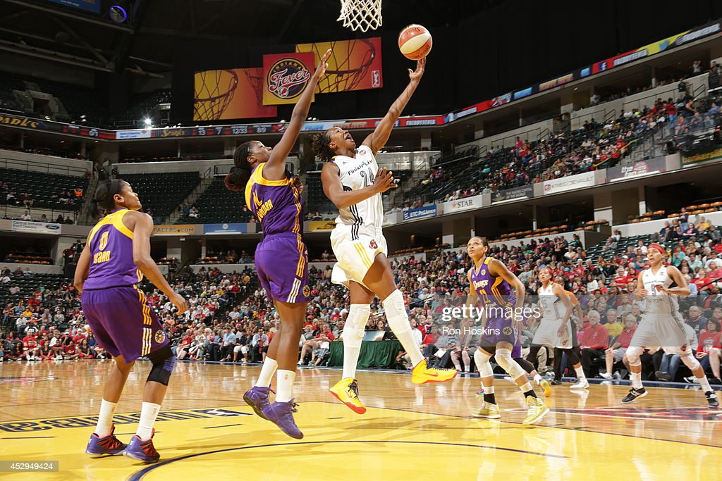 <a gi-track='captionPersonalityLinkClicked' href=/galleries/search?phrase=Tamika+Catchings&family=editorial&specificpeople=202220 ng-click='$event.stopPropagation()'>Tamika Catchings</a> #24 of the Indiana Fever shoots against the Los Angeles Sparks on July 15, 2014 at Bankers Life Fieldhouse in Indianapolis, Indiana.
