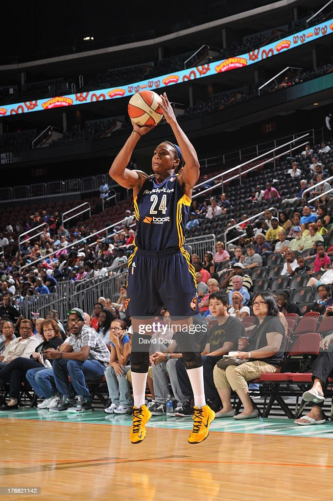<a gi-track='captionPersonalityLinkClicked' href=/galleries/search?phrase=Tamika+Catchings&family=editorial&specificpeople=202220 ng-click='$event.stopPropagation()'>Tamika Catchings</a> #24 of the Indiana Fever shoots against the New York Liberty during the WNBA game on August 30, 2013 at the Prudential Center in Newark, New Jersey.